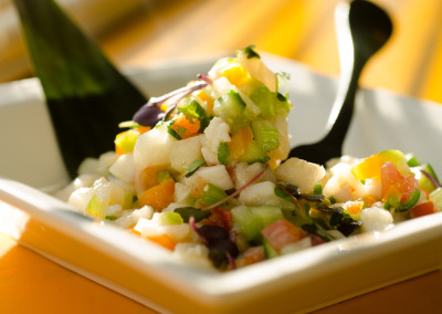 Ceviche ...Tilapia marinated in Lime Juice, Celery, Cilantro,, Serrano Chiles, with Tomatoes and Tomatillos